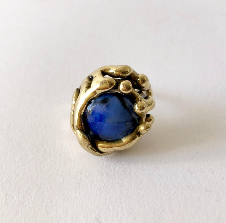 Handmade bronze ring with fused glass stone created by artist and sculptor Michael Schwade of West Fork, Arkansas.  Ring is a finger size 8 to 8.25 and is unsigned. Suitable for a man or woman. In very good condition and unsigned.  I have more