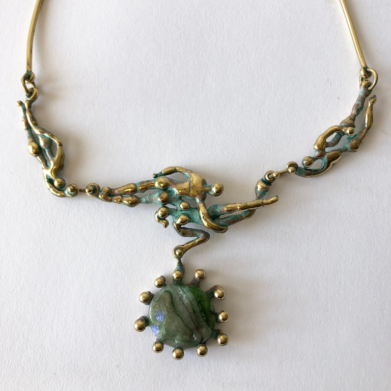 Handmade patinated bronze and glass dancing nudes necklace entitled