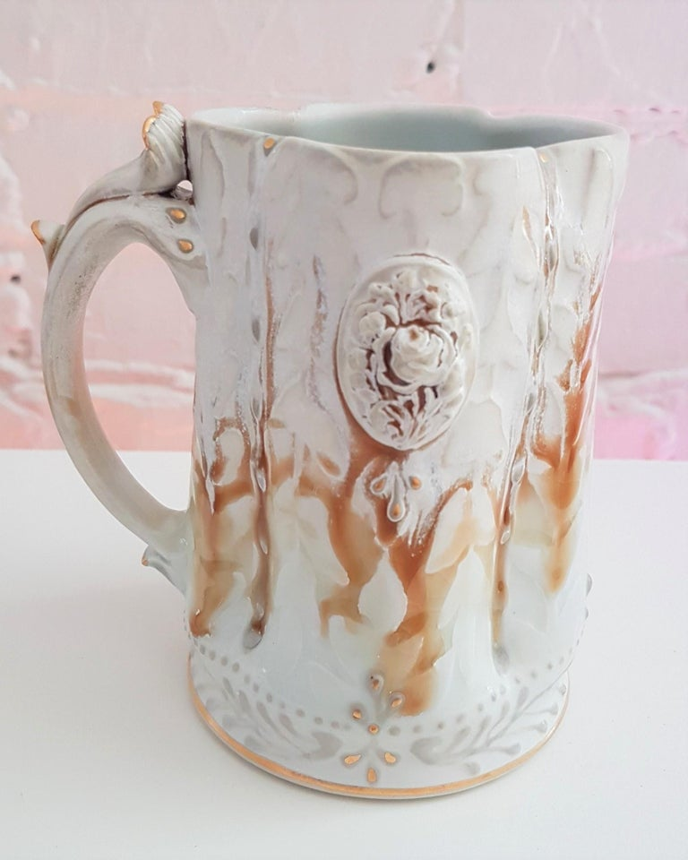 Michael Stumbras Mug Year: 2019 Materials: Porcelain, Gold Luster Size: 5.0 x 4.75 inches  Michael Stumbras work explores the beauty and horror of our existential uncertainties as creatures seeking meaning in a microcosm. These pots combine