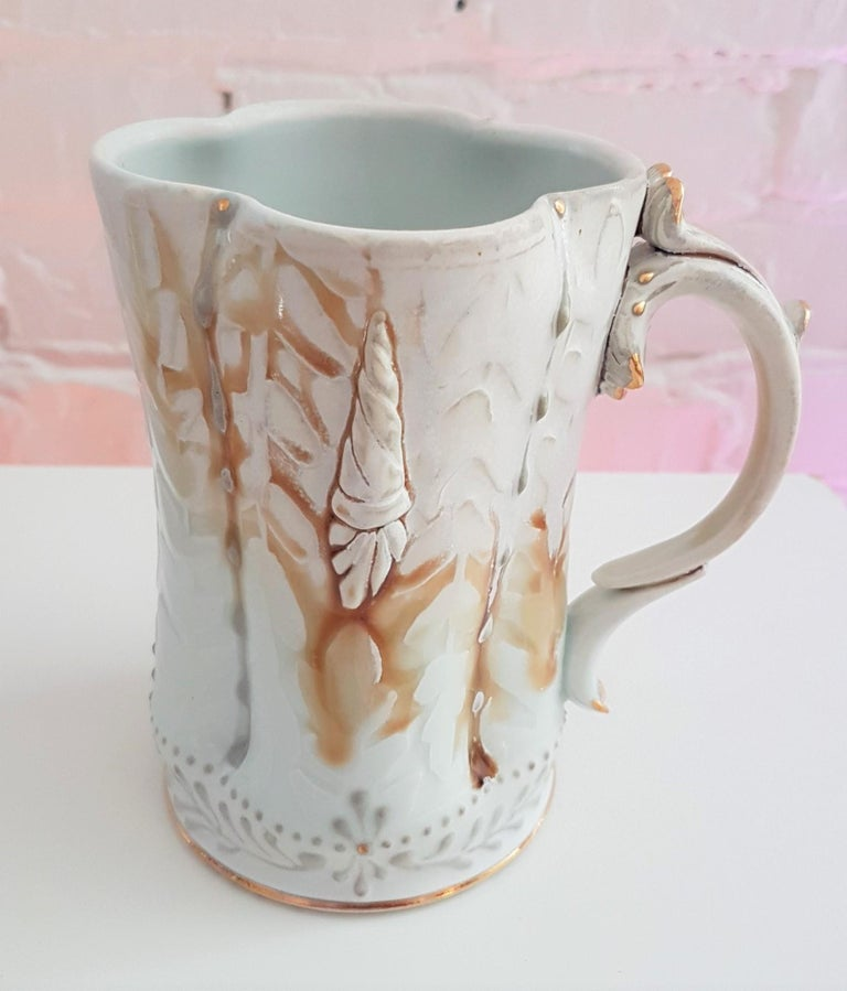 Michael Stumbras Mug Year: 2019 Materials: Porcelain, Gold Luster Size: 5.5 x 5.25 inches  Michael Stumbras work explores the beauty and horror of our existential uncertainties as creatures seeking meaning in a microcosm. These pots combine