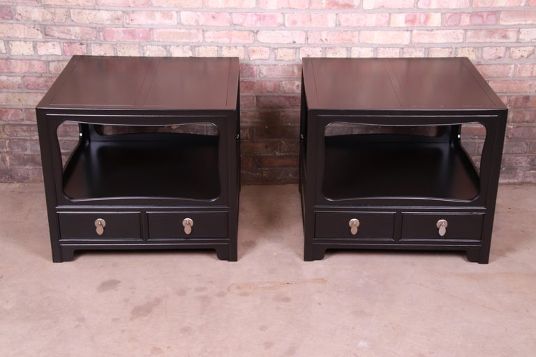 An exceptional pair of mid-century modern Hollywood Regency chinoiserie ebonized nightstands or side tables  By Michael Taylor for Baker Furniture