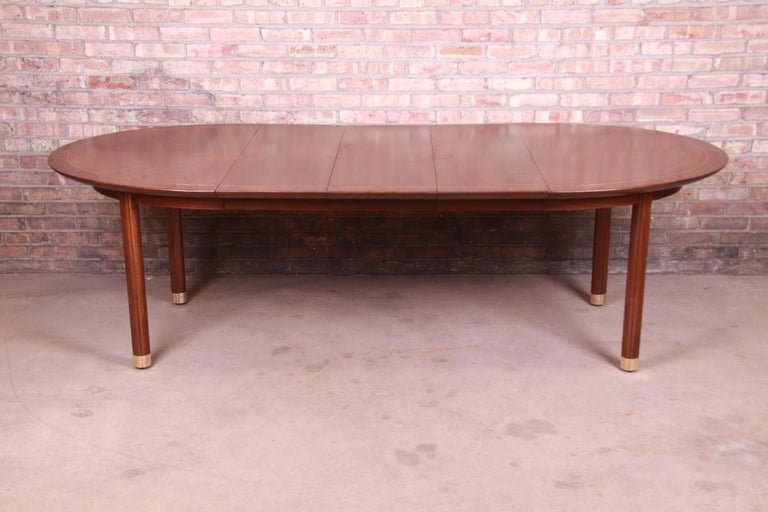 An exceptional Mid-Century Modern Hollywood Regency Chinoiserie extension dining table