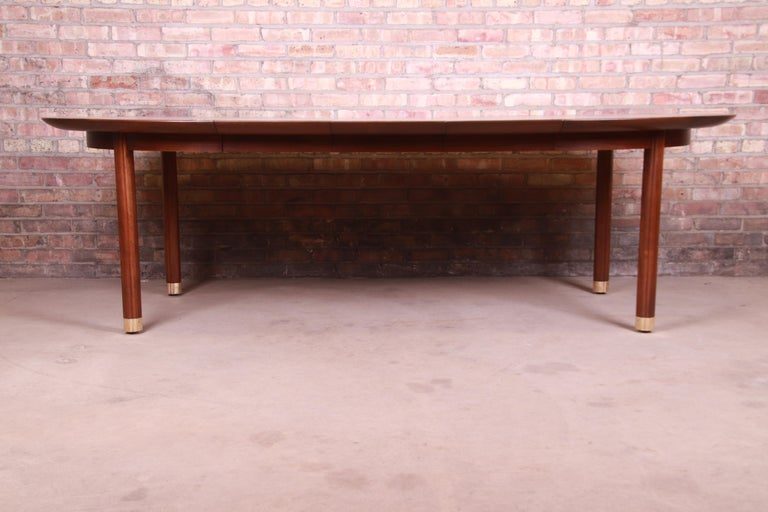 Mid-Century Modern Michael Taylor for Baker Furniture Walnut and Brass Inlay Extension Dining Table For Sale