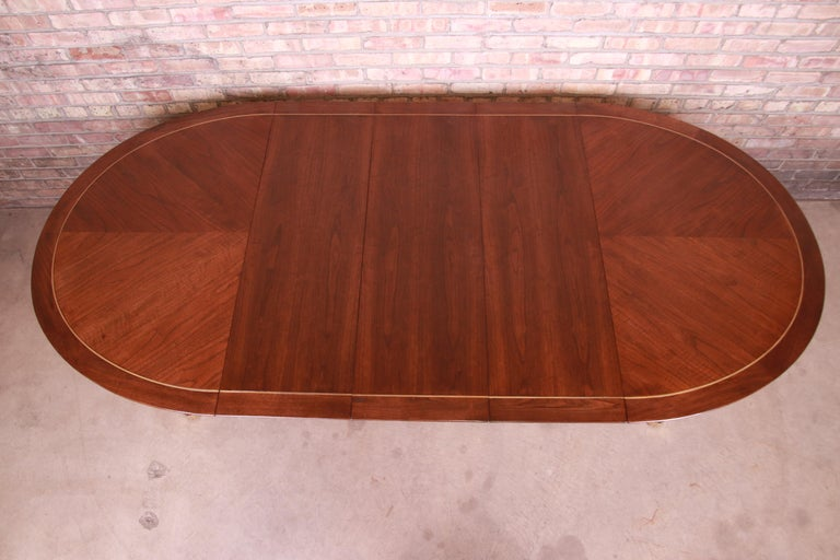 Mid-20th Century Michael Taylor for Baker Furniture Walnut and Brass Inlay Extension Dining Table For Sale