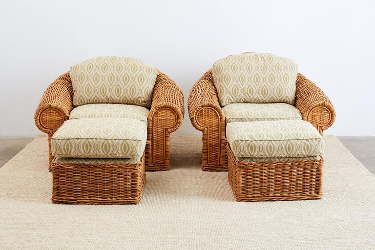 Pair of grand wicker lounge chairs and ottomans inspired by Michael Taylor. Made by Wicker Works in San Francisco, CA. These patio chairs feature a large hardwood frame with a sculptural design known as the Tonda model. Topped with deep seat