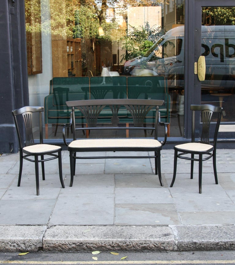 A vintage suite consisting of a bench and two side chairs in black lacquered solid bentwood by Thonet, Austria, first half of the 20th century.