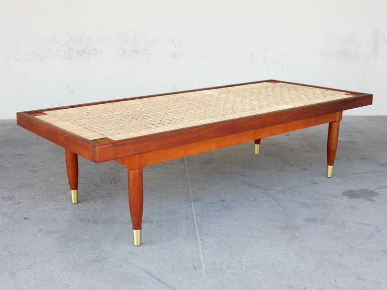 Attributed Michael van Beuren design coffee table, Mexico, circa 1950's. 2-tone hardwood frame with an under-frame strung with rattan, woven in a multi-strand basket weave resembling a checkerboard. An inset piece of glass brings the table