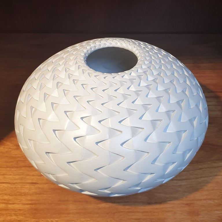 This light-grey Zigzag Vessel is a unique small size contemporary modern ceramic vase shaped vessel by US-artist Michael Wisner. The hand-coiled shape of this object is simple but very elegant, complementing the intense patterning made through a