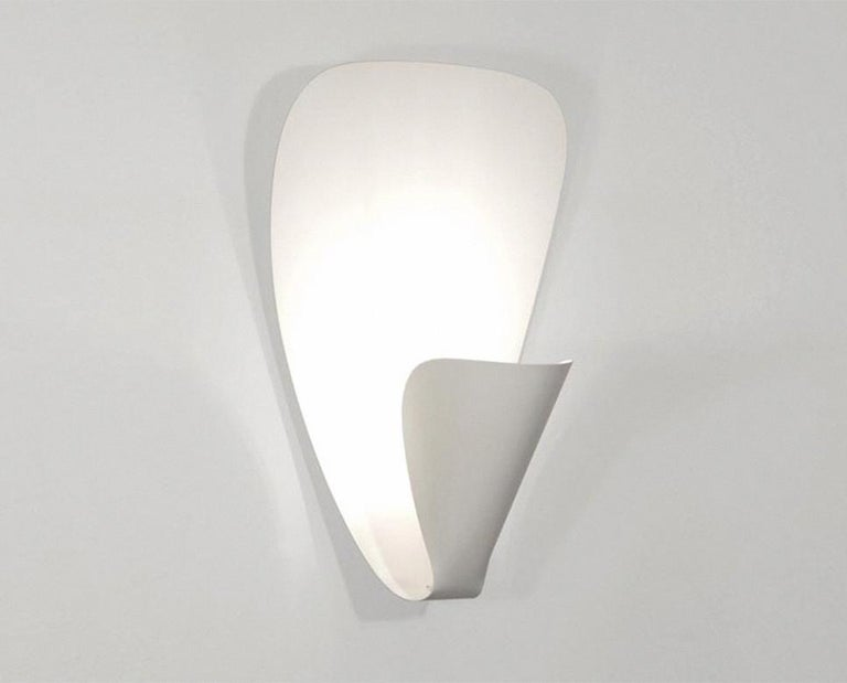 Wall sconce lamp model 'B206' designed by Michel Buffet in 1953.  The production of this re-edition lamps, wall lights and floor lamps are manufactured using craftsman's techniques with the same materials and techniques as the first models. Each