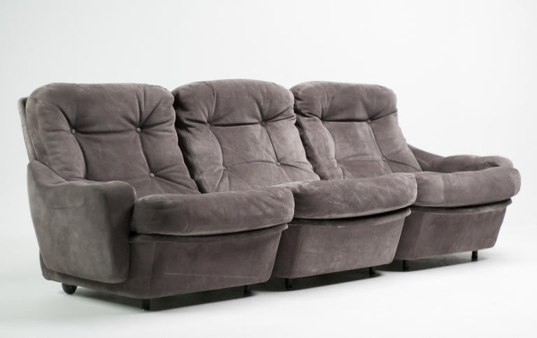 Very comfortable sofas designed by Michel Cadestin for by Airborne International. The sofas are made in suede covered fiberglass with tufted cushions and are very light. They have casters at the rear. Airborne International was a French