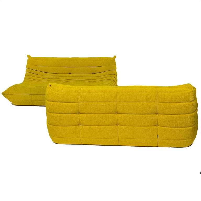 Rare color heavy weave yellow togo sofa designed by Michel Ducaroy for Ligne Roset. Very nice original condition. 3 available- priced per piece. These pieces can be used independently or lined up for one very long sofa. Last photo is from Ligne