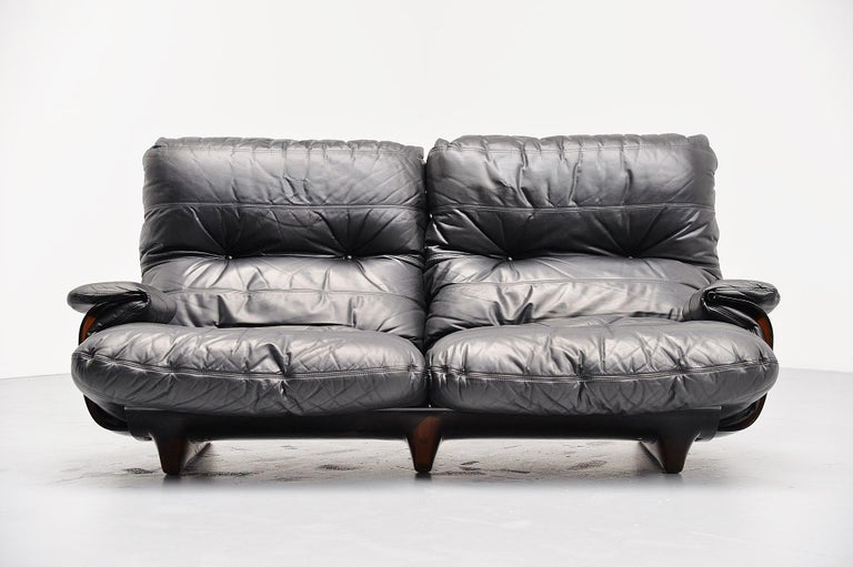 Large lounge sofa designed by Michel Ducaroy, manufactured by Ligne Roset, France, 1970. This is from the Marsala series and this has a brown Plexiglas base and very cozy black leather cushions. Super comfortable lounge sofa in high quality leather.