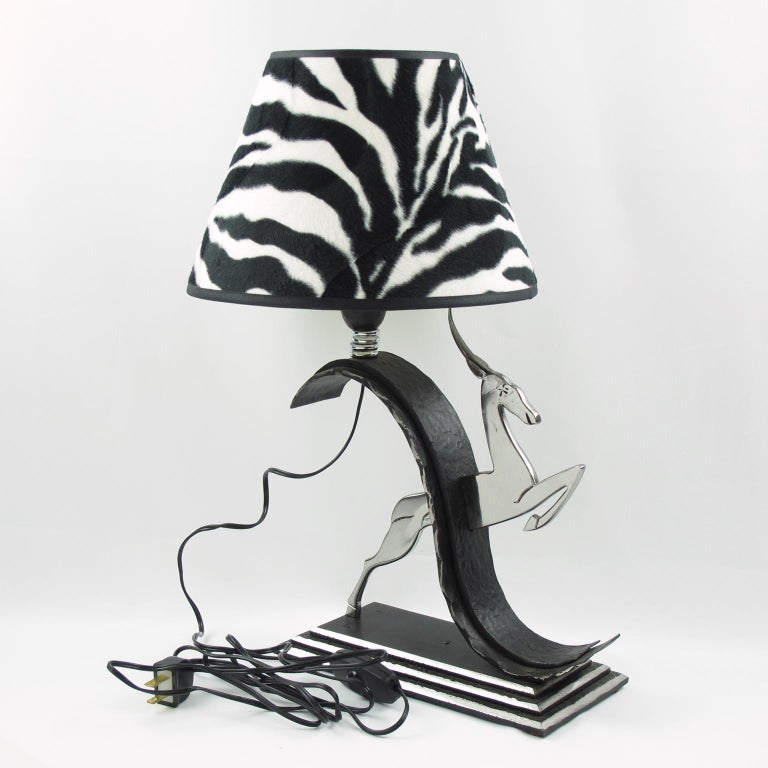 French Art Deco hammered wrought iron and chrome table lamp designed by Michel Zadounaisky (1903-1983). Elegant jumping antelope design mounted on a rectangular tiered base. Rewired to fit US standards. Contemporary shade with a faux fur zebra