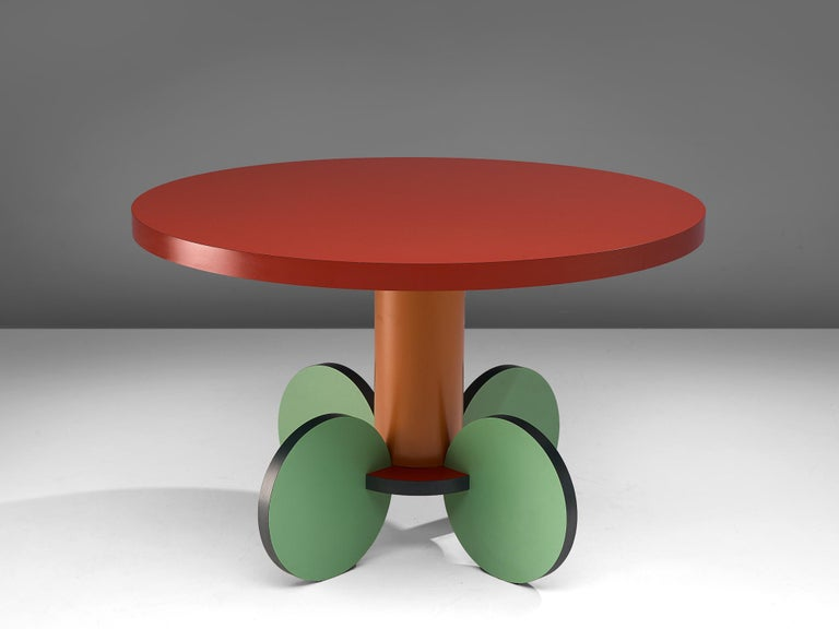 Michele de Lucchi, dining table 'La Festa', laminated wood, Italy, 1984.  Postmodern round dining or center table named La Festa, designed by the Italian Michele de Lucchi. The table features a circular table top in red laminated wood, resting on