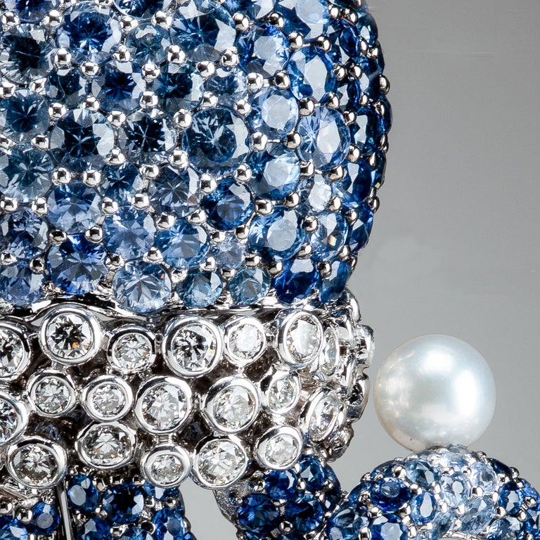 Taking full advantage of the natural color of the stones he selects, Michele della Valle has crafted this fanciful octopus brooch with diamonds, pearls and pave-set sapphires in shades of blue. Each of the fully articulated tentacles playfully