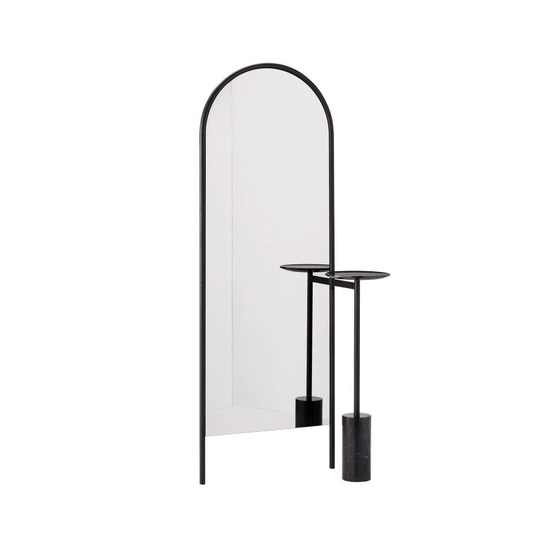 A family of contemporary mirrors with a frame constructed from formed steel tube and feature service elements in polished marble. Frame available in powder coated satin black or with a metallic lacquered brass or pewter finish. Polished marble
