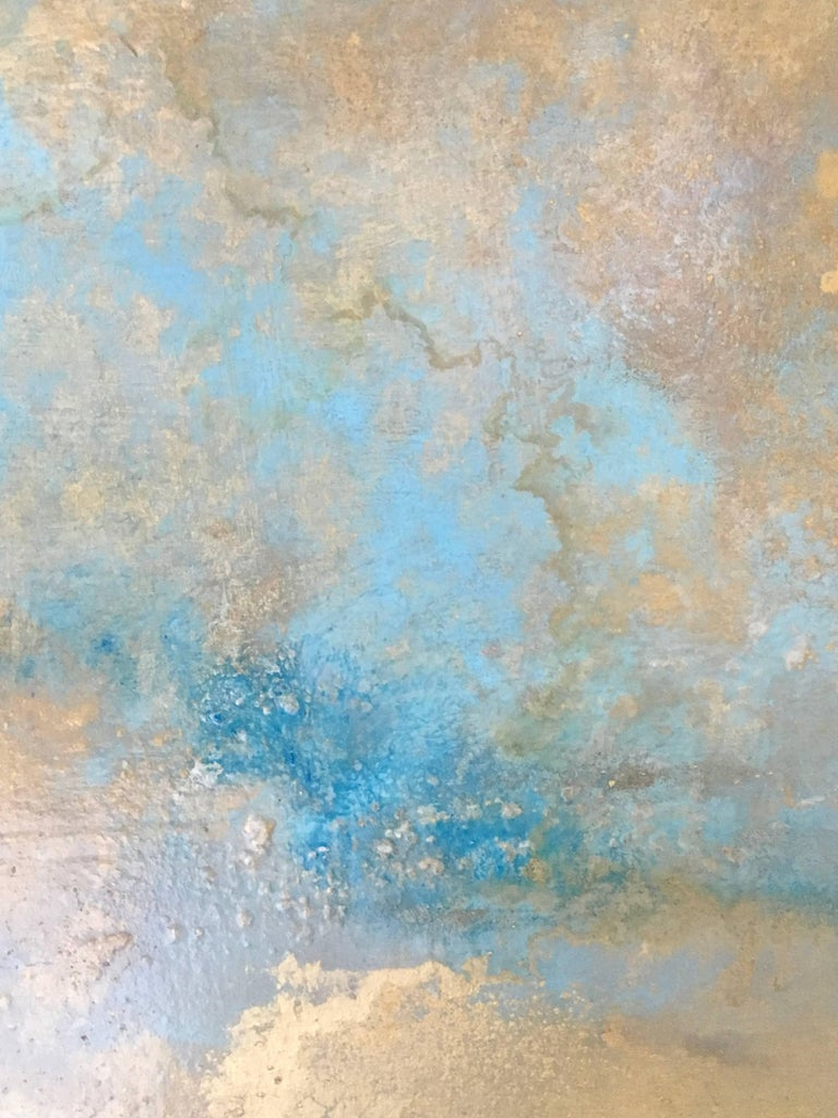 Petit Rhosen is an optimistic skyscape created with oil, gold leaf and varnish on Wood Panel.  It is 35.5x35.5x2.75.  As you move around the painting, the colors shift and the gold leaf picks up the light.  Michelle Gagliano's art is a continuous