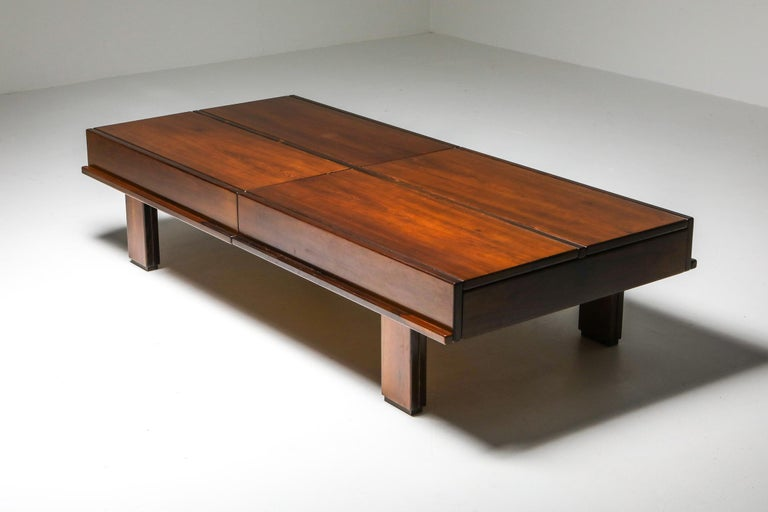 Mid-Century Modern solid wooden coffee table, Michelucci, Italy, 1970s  Solid walnut large coffee table which hides plenty of storage. Each quarter of the table opens up to reveal storage space. Impressed by the design and functionality of this