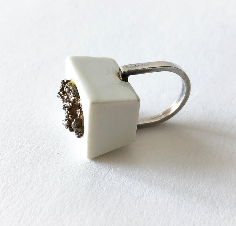 1960's Danish modernist Royal Bini ring created by Anton Michelsen for Royal Copenhagen of Denmark. Ring is a finger size 6 and made up of a porcelain cube with molten sterling silver center accent.  Ring sits about 5/8