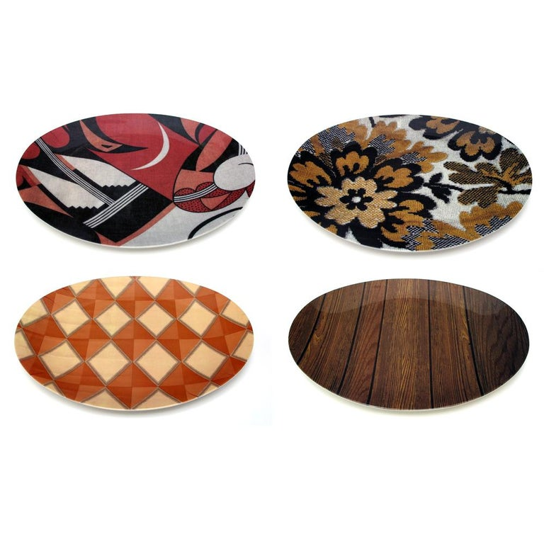 The Mickalene Thomas tray set is in a limited edition of 250. Each set includes a numbered certificate of authenticity and comes in a specially designed package. The set includes four beautiful, oval melamine trays (11 x 14 inches each) with her