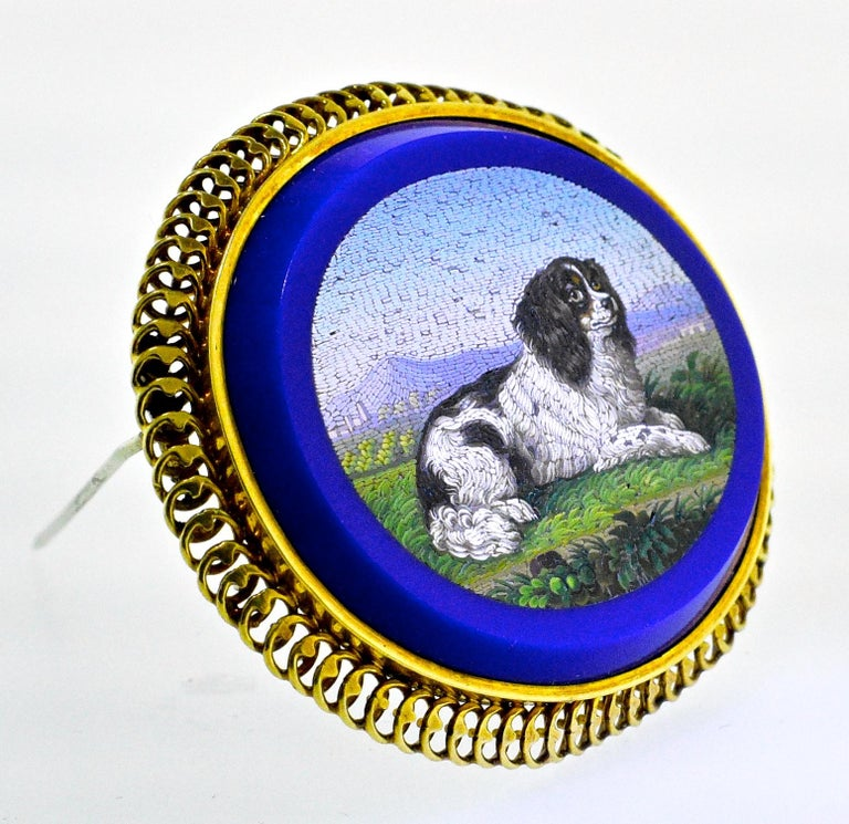 Micromosaic of very fine detail.  Notice the background of shaded mountains, the fine detail of the dog's fur and the foreground of vegetation.  Extremely well done, large and robust with a blue stone background which is much more unusual than the