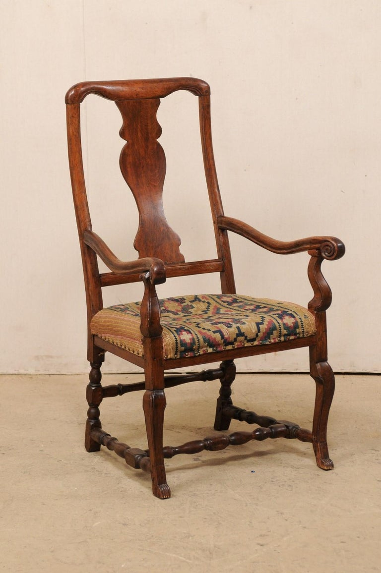 A Swedish carved-wood single arm chair with fabulous old woven fabric upholstery from the mid-18th century. This antique chair from Sweden, though period Rococo, is more subdued in it's carvings, more likely from the country than city. It is quite a