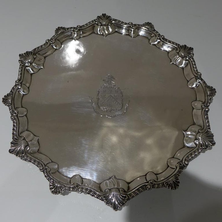 A stunning Georgian silver, mid-sized shaped circular salver, decorated with a stylish applied gadroon border which has interspaced 'fleur de leaf' designs for highlights. The centre front has a beautiful contemporary armorial.