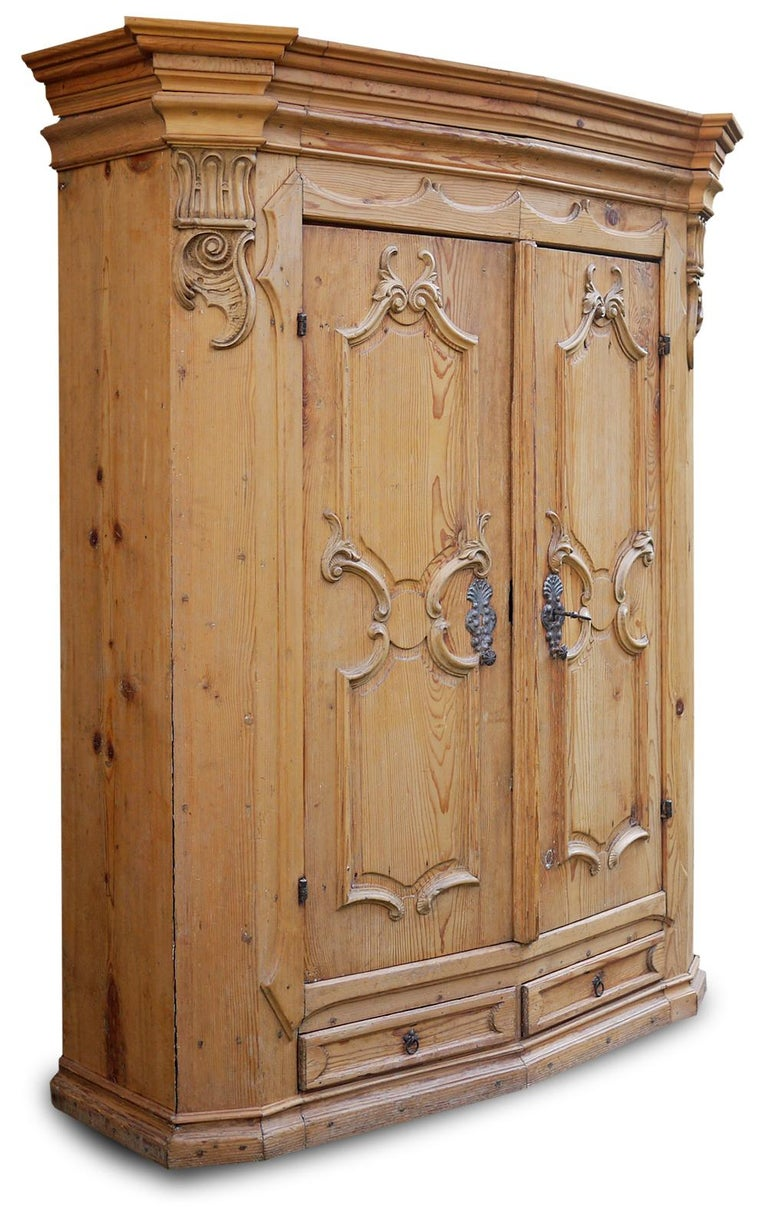 Antique Tyrolean (Northern Italy) carved wardrobe, mid-18th century  Measures: H. 187cm, L. 156cm, P. 60cm  Wardrobe with two doors and two drawers, notched, in fir wood. The front is slightly convex, a typical process in the area of?? Origin of