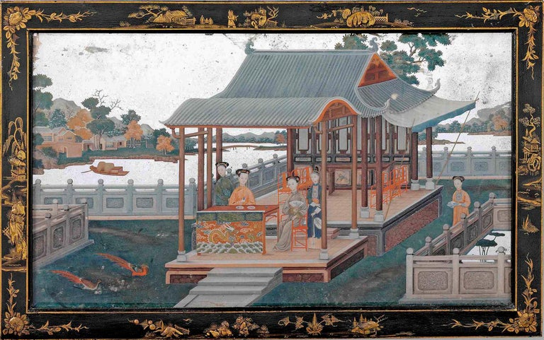 A fine quality and rare mid-18th century export beveled mirror painting, depicting ladies taking tea in a pagoda, the background with a river, buildings and mountainous landscape, set in its original black and gilt japanned frame.