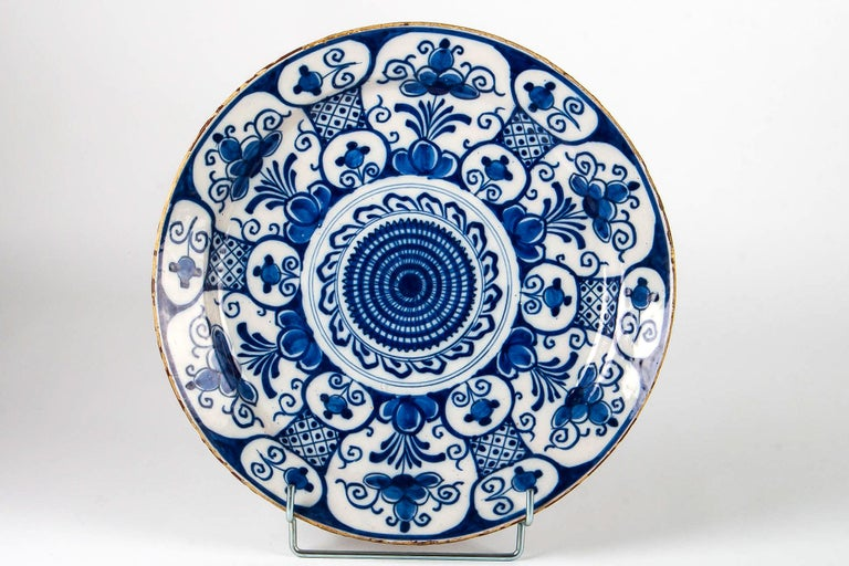 Mid-18th century, Delft Faience round dish, circa 1750  Elegant and decorative Delft Blue Cameo hand painted earthenware round dish, depicting rosettes and flowers.  Beautiful Dutch work, mid-18th century by the earthenware Delft factories,