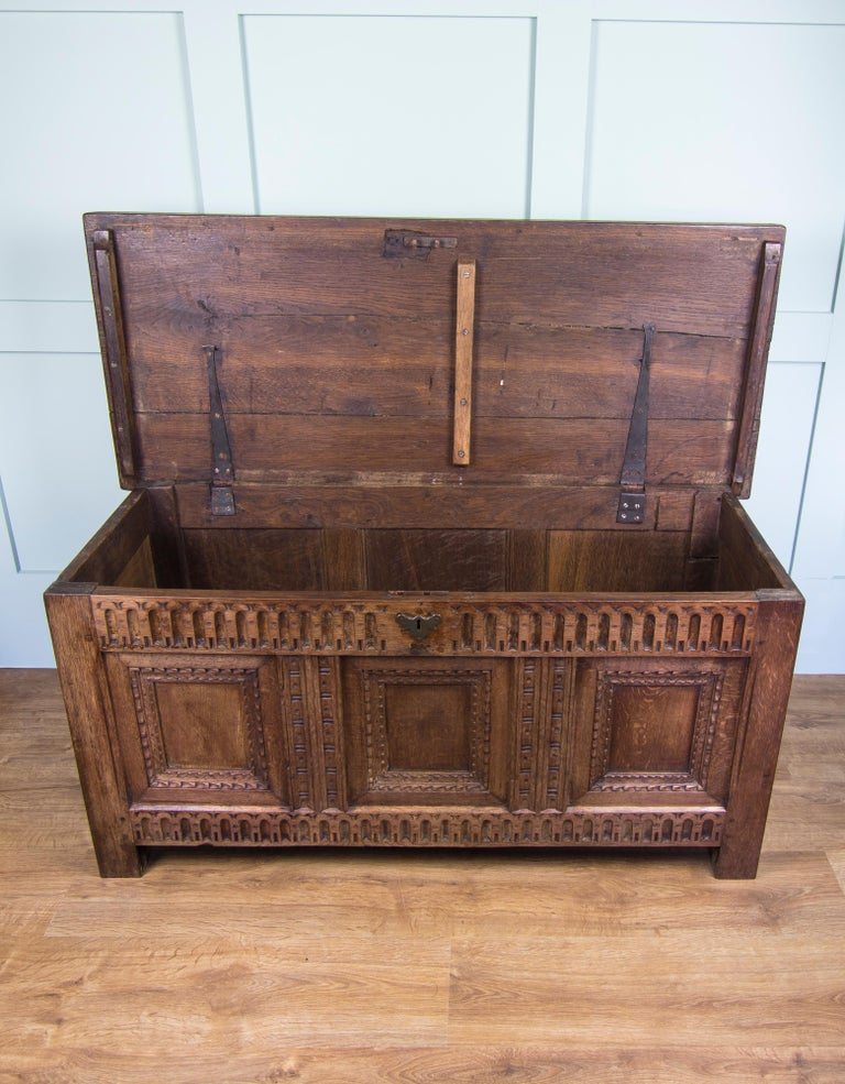 British Mid-18th Century Oak Coffer Chest with Three-Panel Decorative Front For Sale