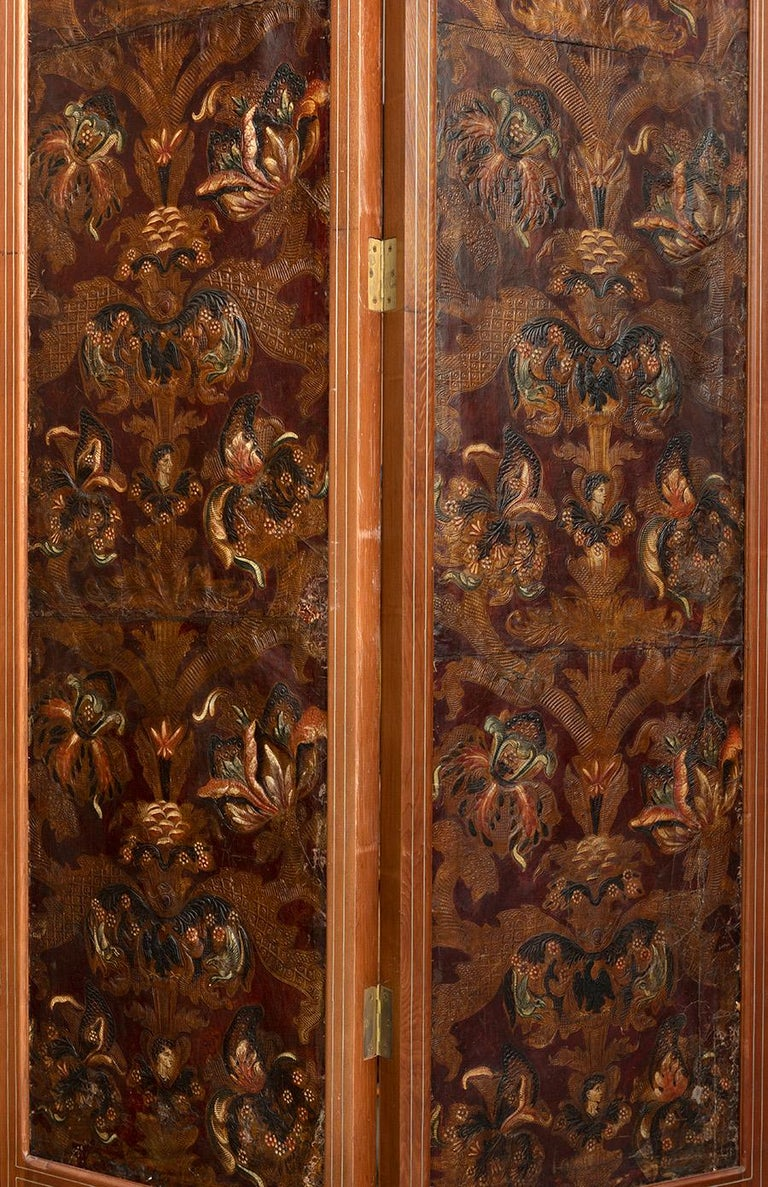 Mid-18th century Spanish set of two 4-panel oak embossed leather folding screens in Cordoba manner with gilt, colorful polychromy, bone and