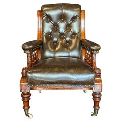 Mid 19th Century Brown Leather Library Chair with Carved Dolphin Arms, Mahogany