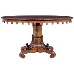 Mid-19th Century Carved Flame Mahogany Oval Center Table