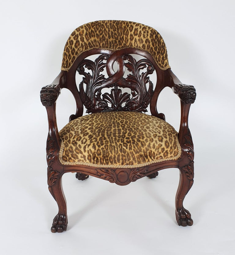A mid-19th century French carved walnut desk chair with a horseshoe shaped back decorated with stylised dolphins. This gorgeous chair stands on carved paw feet with the original castors. It measures 26 ½ in – 67.3 cm wide, 23 ½ in – 59.7 cm deep and