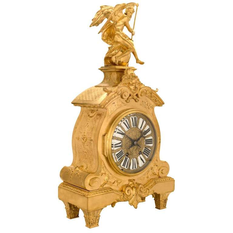 A handsome and high quality mid-19th century French Louis XIV style ormolu clock. The clock is raised by four tapered fluted legs decorated with acanthus leaves. The scalloped shaped center frieze is with a central reserve of 'S' scrolled acanthus