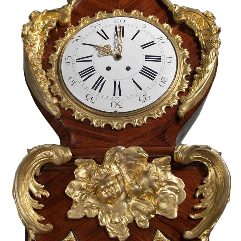 A most spectacular and high quality mid-19th century French Louis XV style grandfather clock. Tulipwood inlay and decorated with all original ormolu mounts. The clock is raised by an impressive moulded base with ormolu paws and a large band. Above