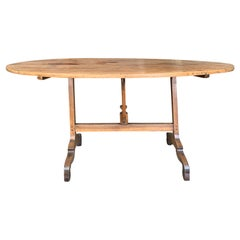 Mid-19th Century French Rustic Oval Wine Tasting Table with Trestle Base