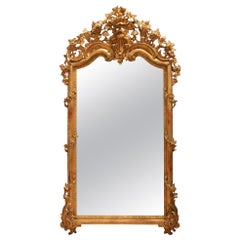 Mid-19th Century Grand Scale Italian Richly Carved Giltwood Mirror