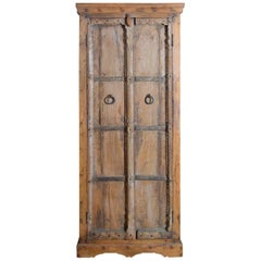 Mid 19th Century Indian Armoire with Hand-Carved Motifs and Metal Stretchers