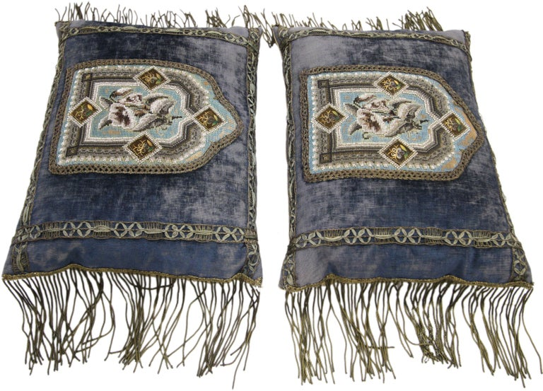 77186-87 pair of mid-19th century antique Italian metallic embroidered velvet pillows with metallic fringe. This pair of antique Italian pillows displays a deep indigo blue background with Italian metallic applique. It is embroidered with a gold