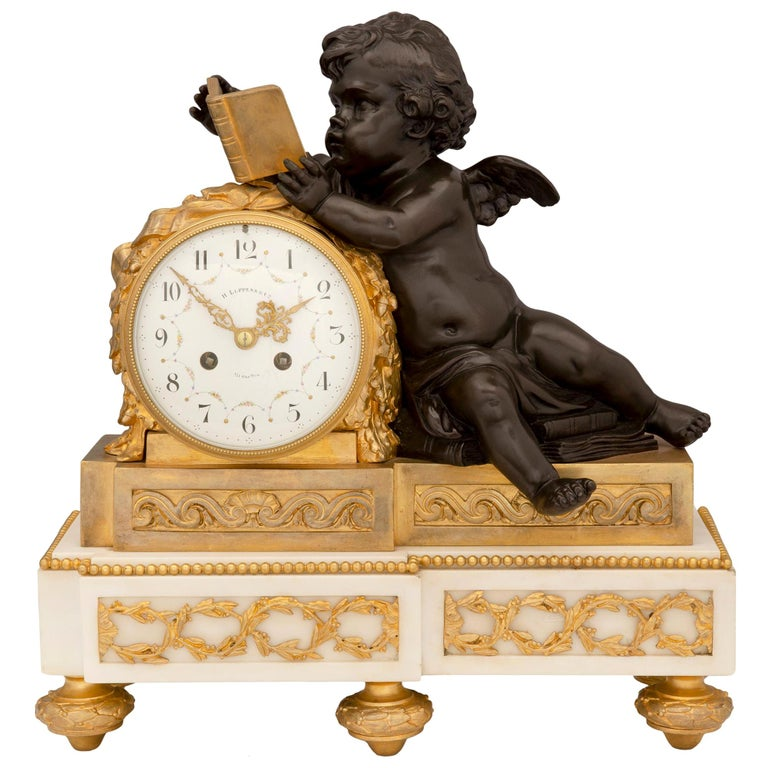 Mid-19th Century Louis XVI Style Patinated Bronze, Ormolu and Marble Clock For Sale