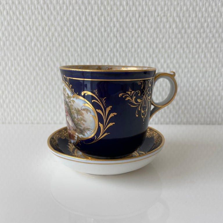 Mid-19th century Meissen cobalt blue with beautiful scene painting coffee cup saucer  2-part mocha setting from Meissen. Decor: cobalt blue background with beautiful scene painting. Dimensions: Saucer diameter approx. 8cm. Cup diameter approx.