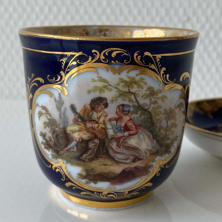 Hand-Painted Mid-19th Century Meissen Cobalt Blue with Scene Painting Coffee Cup Saucer For Sale