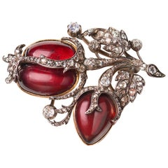 Mid-19th Century Red Cabochon Garnet and White Diamond Brooch