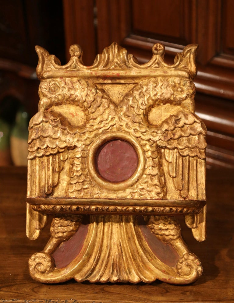 Place your Bible, music sheet or a recipe book on this antique, rococo book stand. Crafted in Spain, circa 1860, the decorative lectern sits on small tripod and features hand carved motifs on the front. The book stand is carved with a center