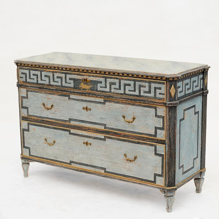 Chest of drawers, Gustavian style. Painted in blue shades. Tabletop blue-gray marbled. Upper drawer with 'à la grecque' motif. Original spring locks. Sweden, 1820-1840. Very decorative.