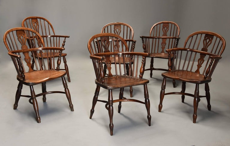 A well matched set of six mid-19th century (circa 1840) yew wood low back Windsor armchairs, five of the chairs matching with one very similar additional chair all of superb patina from the Rockley area of Nottinghamshire.  This set of chairs each