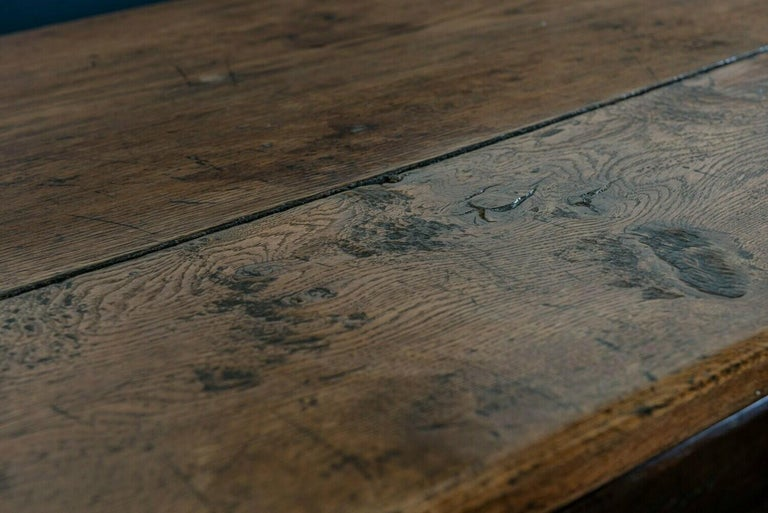 Mid-19th centuryFrench 2 plank oak trestle table Fantastic color and worn patina with lovely burr. Pegged construction, and displaying the makers mark.  Measures: W 183 (6