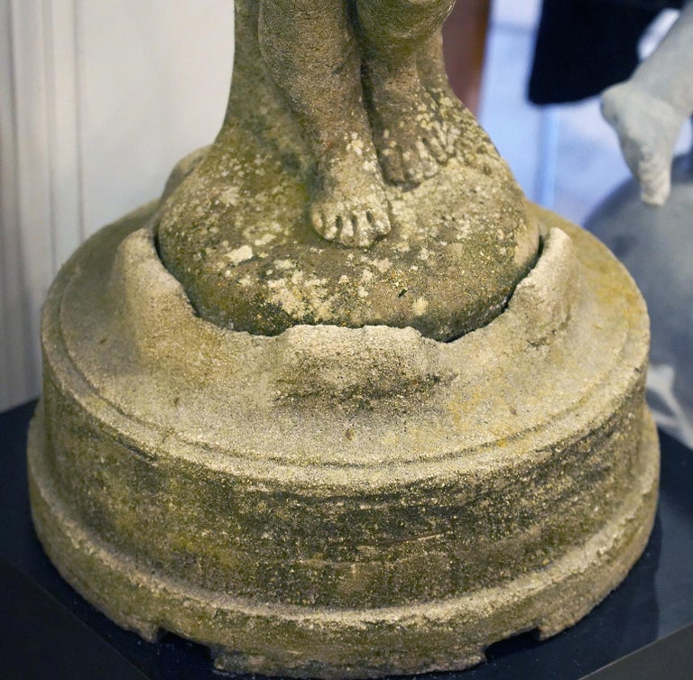 Rococo Mid-20th C. Cement Statue of a Putti Holding Grapes and Shell on a Fitted Base For Sale
